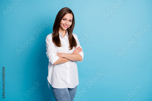 Profile photo of attractive lady hands arms crossed office worker wear white shirt jeans isolated blue color background - 386885164