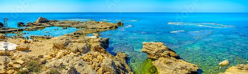 Fotografia, Obraz The sharp rocks on the shore of Caesarea, Israel