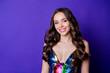 Leinwandbild Motiv Photo of positive lovely girl look in camera wear glossy dress isolated over bright color background