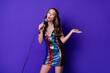 Leinwandbild Motiv Photo of funny girl sing song karaoke hold mic isolated over shine violet color background
