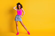 Full length body size view of her she nice attractive pretty glad cheerful cheery wavy-haired girl posing having fun free time copy space isolated on bright vivid shine vibrant yellow color background