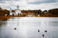 Lake With Ducks Near The Churc...