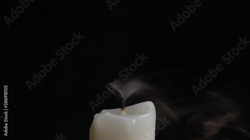 Photo of smouldering candle's wick on black background Wallpaper Mural
