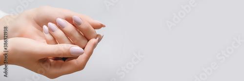 Fototapeta Female hands with rose nail design. Pink glitter nail polish manicure on white background, banner obraz