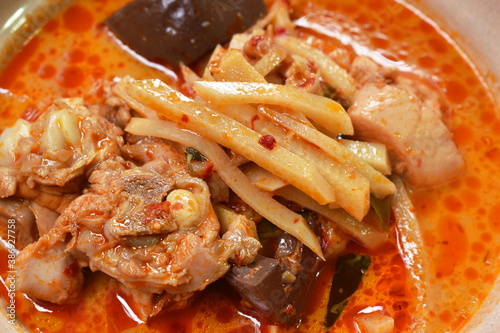 Cuadros en Lienzo spicy boiled slice fresh bamboo shoot with chicken and blood in coconut milk cur