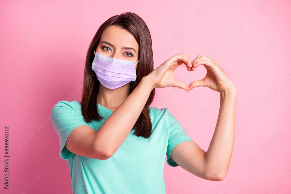 Fototapeta Photo portrait of girlfriend hands in heart shape in teal t-shirt respirator isolated on pastel pink color background