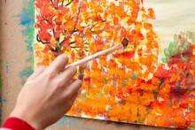 Young Artist Paints Orange Aut...