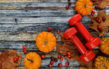 Two Red Dumbbells With Pumpkin...