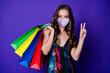 Leinwandbild Motiv Photo of positive cheerful girl hold bags make v-sign wear respirator skirt isolated over bright shine purple color background