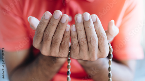 Close up Religious muslim man praying with rosary beads in hand Canvas