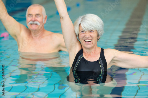 Fototapeta active seniors doing water exercises obraz