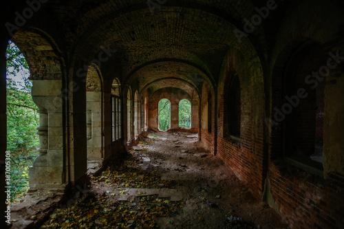 Stampa su Tela Dark corridor of old ancient abandoned red brick ruined historical building