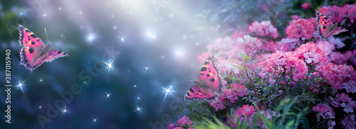 Obraz Fantasy Magical Enchanted Fairy Tale Dreamy Elf Forest with Fabulous Fairytale Blooming pink Rose Flower Garden and Butterflies on Mysterious Background, Shiny Glowing Stars and Moon Rays in Night - fototapety do salonu