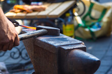 Blacksmith Performs The Forgin...