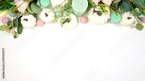 Happy Thanksgiving table setting with white vintage style plates, gold silverware, and centerpiece with greenery, pink, and white pumpkins, on white tablecloth Fototapeta