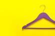 Leinwandbild Motiv Clothes hanger on color background
