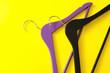 Leinwandbild Motiv Clothes hangers on color background