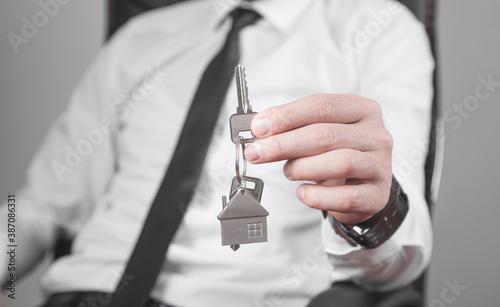 Fototapeta Real estate agent holding house keys.
