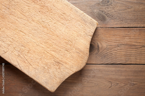 Fototapeta Old cutting board on wooden background obraz na płótnie