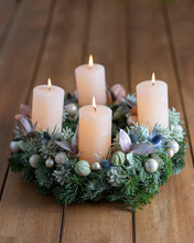 Advent Wreath With Four Burning Candles On Table