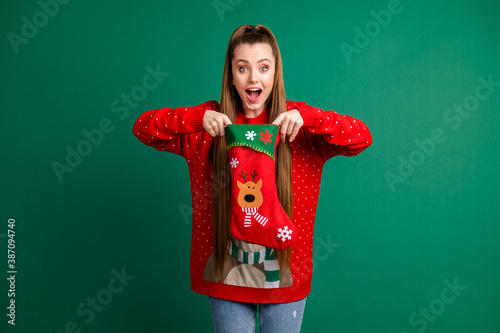 Obraz na plátně Photo of attractive funny excited lady hold newyear stocking x-mas morning waiti