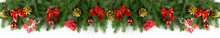 Very Wide Christmas Border With Fir Branches, Golden Cones, Red Bows And Balloons And Other Decorations Isolated On White