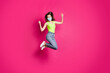 Leinwandbild Motiv Full body photo of excited young girl celebrate jump up wearing blue face mask isolated over pink color background