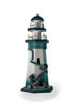 A Figurine In The Form Of A Lighthouse With A Large Anchor In The Foreground. Isolate.