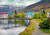 Gloomy morning cityscape of small fishing town - Seydisfjordur. Colorful summer scene of east west Iceland, Europe. Traveling concept background.