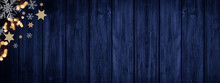 Festive Decorative Christmas / Advent Background Banner Panorama Template - Bokeh Lights, Stars And Ice Crystals, Isolated On Dark Blue Rustic Wooden Boards Wall Texture, With Space For Text