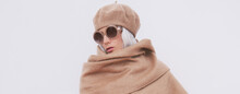 Stylish Blonde Girl In Beige Beret And Scarf. Fashion Sunglasses. Details Of Everyday Look. Trendy Minimalistic Style. Beige Aesthetics. Fashion Look Book. Warm Fall Winter Seasons Concept