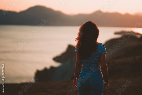Picturesque mountain landscape at sunset with the sea on the horizon, a young be Fototapeta