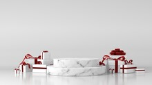 White Marble Podium For Product Placement In Christmas Background Decor By Gift Boxes Ribbon