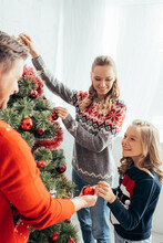 Happy Kid Decorating Christmas...