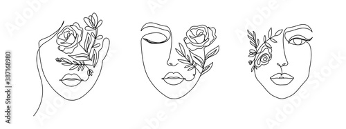 Canvas Print Women's faces in one line art style with flowers and leaves