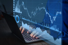 Trading On Stock Exchange Market And Investment Strategy For Financial Assets With Person Using Online Software To Analyze Price Statistics And Trade From Home At Night To Make Profit