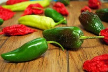 Fresh Jalapeno Habanero And Banana Pepper On A Wooden Background