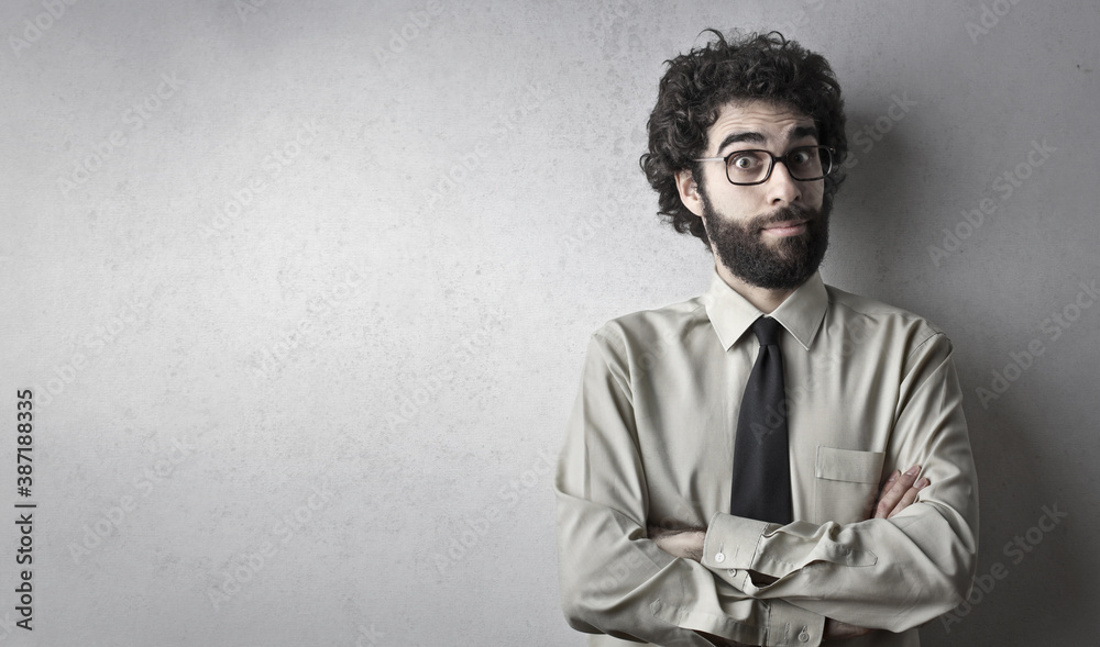 Fototapeta portrait of  a young businessman on a grey background