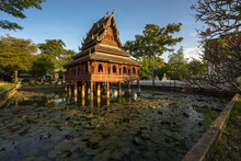 Thai Wooden Temple Architecture On The Lotus Pond, Beautiful And Famous Temple In The Province, Wat Thung Si Muang, Ubon Ratchathani, Thailand.