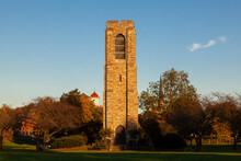 Scenic Autumn Image Of The Joseph D. Baker Tower And Carillon At Sunset Located In Baker Park, Frederick. Trees With Autumn Colors And Three Other Historic Towers Are Seen In Background
