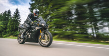 Triumph Daytona Triple Racing Motorbike On The Road Driving Fast. Having Fun On The Empty Highway