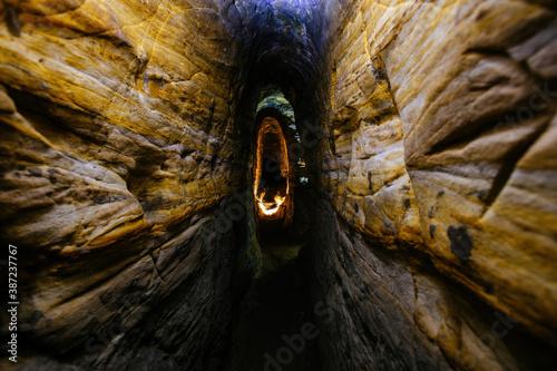 Cuadros en Lienzo Ancient narrow underground passage in sandstone at old underground monastery