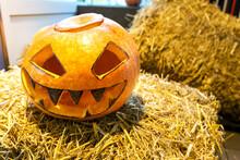 A Pumpkin On A Straw With An A...