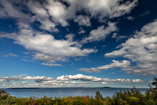 Soaring Clouds Over The Ocean Of Frenchman's Bay And The Area Surrounding Schooner Head Overlook In Acadia National Park, Maine