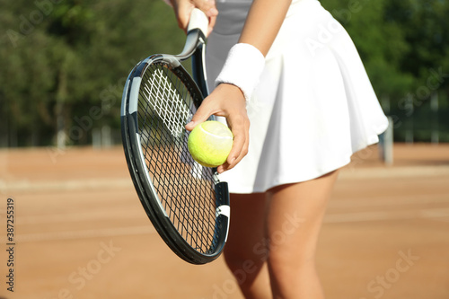 Obraz Sportswoman preparing to serve tennis ball at court, closeup - fototapety do salonu