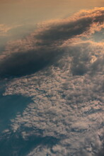 Portrait Image Of A Curtain Of Clouds, Formed By Small Tufts, With Its Top Illuminated By Twilight.