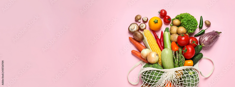 Fototapeta Many fresh different vegetables on pale pink background, top view with space for text. Banner design