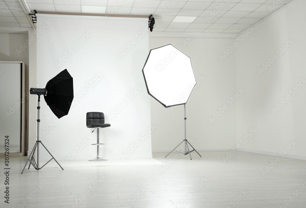Fototapeta Photo studio interior with set of professional equipment