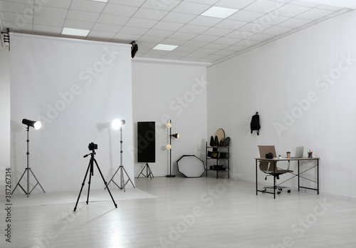 Photo studio interior with set of professional equipment and workplace Canvas