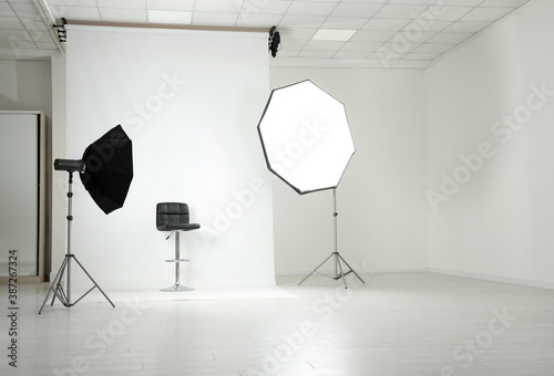 Fototapeta Photo studio interior with set of professional equipment obraz